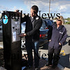 Newburyport: Technician Noah Cruzan shows people, including parking officer Diane Rohner and City Clerk Richard Jones, how the new parking machine works in the parking lot at the Waterfront Trust. People will put coin or credit card into the machine and receive a ticket that will be display ed on their dash. Bryan Eaton/Staff Photo