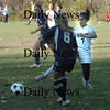 Amesbury: Amesbury's Janine Fatal  knocks the ball away from a Wilmington player. Bryan Eaton /Staff photo