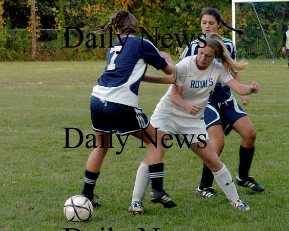 Georgetown: Georgetown's Nicoline Holland battles with Hamiton-Wenham's Louisa Delrio for the ball yesterday in Georgetown. Bryan Eaton/Staff Photo