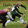 West Newbury: Clipper's Taylor Purcell, left, is challenged by Pentucket's Molly Sanford. Bryan Eaton/Staff Photo