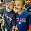 Amesbury: Miles Franey, 7, left, and Jeremy Lopez, 6, show their allegiance to the Boston Red Sox as they stand in the lunch line. Students and staff at Amesbury Elementary School dressed up in Red Sox clothes as the team kicked off its postseason play last night against the Angels. Bryan Eaton/Staff Photo