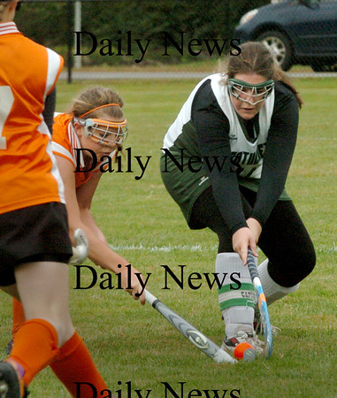 West Newbury: Pentucket field hockey player Sarah Dillon, right, tries to move the ball past Ipswich's Lauren Mazzola. Bryan Eaton/Staff Photo