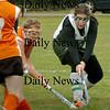 West Newbury: Pentucket field hockey player Sarah Dillon, right, tries to move the ball past Ipswich's Lauren Mazzola. Bryan Eaton/Staff Photo