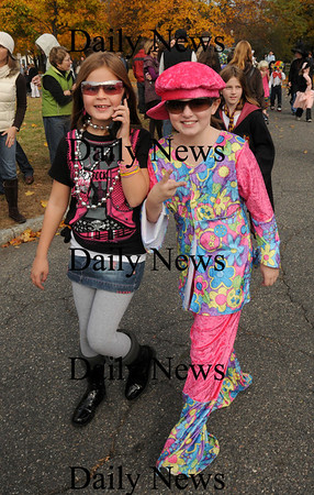 "Newburyport: Alexandra Trego, left, dresses as a diva with pal, Sarah Childs, both 8, as a Woodstock-inspired ""hippie"" at the Bresnahan School's Halloween Parade. Bryan Eaton/Staff Photo"
