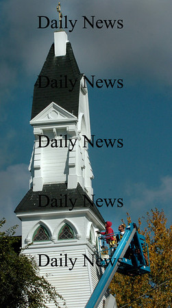West Newbury: Workers have been making repairs and giving a new paint job to St. Anne's Church in downtown West Newbury for the past couple weeks. Bryan Eaton/Staff Photo