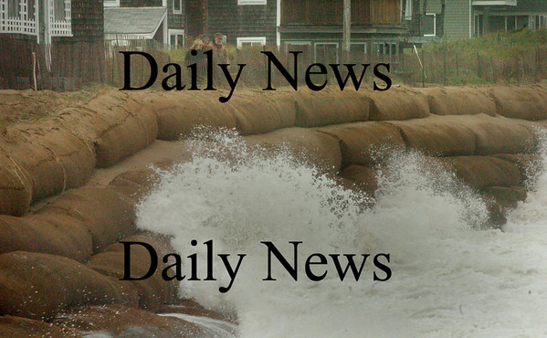 Newbury: Waves splash onto the giant sand bags at Plum Island center yeseterday about an hour after high tide. Bryan Eaton/Staff Photo