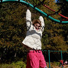 Amesbury: Anna Penny, 7, moves along the monkey bars during recess at the Cashman School in Amesbury yesterday afternoon. Children get nice weather for recess through the end of the week. Bryan Eaton/Staff Photo