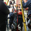 "Newburyport: Fire and rescue personnel pull Boston firefighter Neal Mullane from a shaft during rescue training on Thursday afternoon. Sent in as a rescuer of someone trapped in the shaft, he had to be ""rescued"" as well, his breathing apparatus ""failed."" Bryan Eaton/Staff Photo"