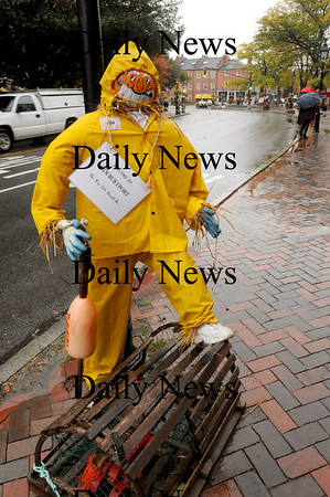 Newburyport: This lobsterman scarecrow in Newburyport's Market Square was dressed appropriately for Tuesday's rain storm. More rain may be in the forecast for the early part of the weekend. Bryan Eaton/Staff Photo