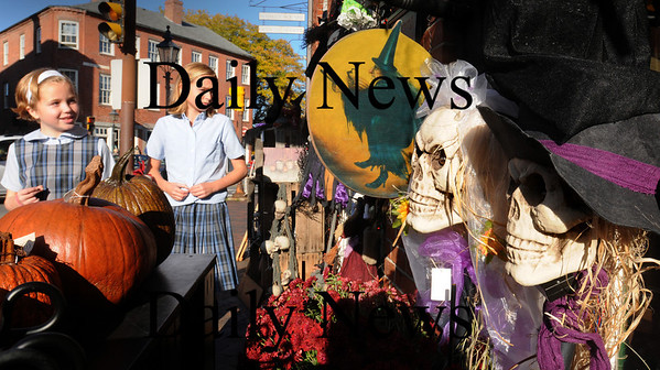 """Newburyport: Newburyport merchants and restaurants are getting into the Halloween """"spirit"""" for Friday's Witches Night Out. Sisters Ali Bergin, 8, left, and Mara, 11, of Newbury check out the display at Partridge in a Bear Tree in Market Square yesterday afternoon. Bryan Eaton/Staff Photo"""