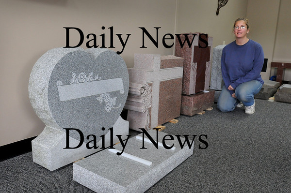 Merrimac: Alisa Cote, and partner Anthony Coco, have relocated their A&A Monuments to 69 East Main Street in Merrimac. Plans to rebuild the strip mall that they were located in, which burned down in April, haven't progressed. Bryan Eaton/Staff Photo