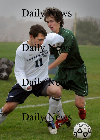 Byfield: Triton's Collin Smith moves the ball past a Manchester Essex player yesterday in Byfield. Bryan Eaton/Staff Photo