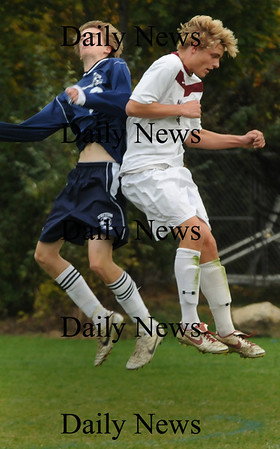 Newburyport: Triton player Eric Peterson, left, bumps with Newburyport's Stephen Bajko trying to move the ball with their heads. Bryan Eaton/Staff Photo