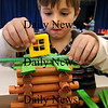 Amesbury: Parker Wile, 6, adds a second floor to the cabin he's building with Lincoln Logs while at the afterschool program at Amesbury Elementary School on Tuesday afternoon. Bryan Eaton/Staff Photo