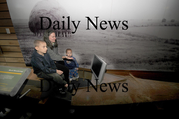 Newbury: Ann Barndt and her sons Mathew, 1, and Andrew,10, watch a video while sitting in a flat boat at the Wildlife Celebration Day at the Parker River Wildlife Refuge Headquarters Saturday. JIm Vaiknoras/Staff photo