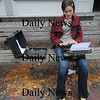 Newburyport: Newburyport high school sophmore Tayor Howard uses a Royal typewriter to write poetry in Market Square in Newburyport Friday afternoon. Taylor feels the typewriter is more reliable than more modern writing equiptment. Jim Vaiknoras/Staff photo