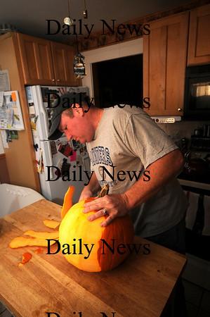 Newburyport:Jeff Saunders of Newburyport carves a pumpkin.Jim Vaiknoras/Staff photo