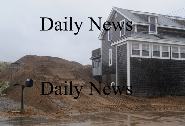 Newbury: Sand piled at 16 Northern Blvd on Plum Island to help protect it from Sunday's storm. Jim Vaiknoras/Staff photo