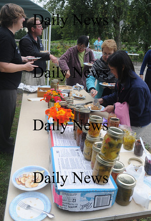 Newbury: People sample entries in the New Eden food contest Sunday at teh First Parish Church. Jim Vaiknoras/Staff photo