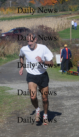 Amesbury : Mens winner of the 2nd annual Cider Marsh 5k Orchard Walk at the Cider Hill Farm in Amesbury Sunday afternoon. Jim Vaiknoras/Staff photo