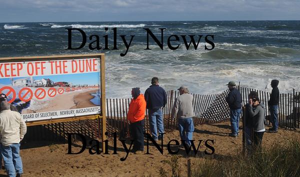 Newbury: People gather to watch the high surf Saturday on Plum Island. Jim Vaiknoras/Staff photo