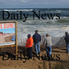 Newbury: People gather to watch the high surf Saturday on Plum Island. Jim Vaiknoras/Staff photo