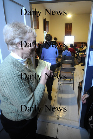 Amesbury: Barbara Haack greets  people as they enter the Friends Meeting House sunday to hear a talk by Afghani exile Zoya. Jim Vaiknoras/Staff photo