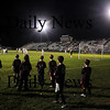 Newburyport: Members of Newburyport Youth Soccer watch as Newburyport high plays Pentucket in the 8th annual ALS Soccer Cup at War Memorial Stadium in Newburyport Thursday night. Jim Vaiknoras/Staff photo