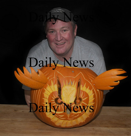 Newburyport:Jeff Saunders of Newburyport with one of his sculpures.Jim Vaiknoras/Staff photo