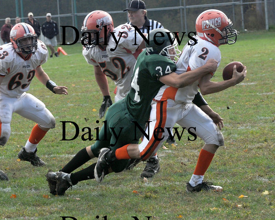 West Newbyrt: Ipswich's Brendan Gallagher is sacked by Pentucket's CJ Lataille during their game in West Newbury Saturday. Jim Vaiknoras/Staff photo