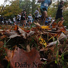 West Newbury: Runners in the 20th annual Apple Harvest Race in West Newbury dash by fallen leaves as they make their way down Batchelor street Sunday morning. Jim Vaiknoras/Staff photo