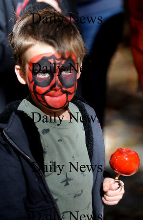 Salisbury: Elias Wiggins, 5, enjoys a candy apple at the Fall Feastival and Halloween Hayride Sunday. Along with the hayride kids enjoyed pumpkin decorating, snacks and loads of ghoulish fun. The event was sponsered by the Salsibury Recreation Dept. Jim Vaiknoras/Staff photo