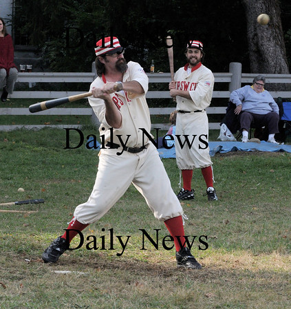Newbury: Jim Droau of the Ipswich Brewery team takes a bead on the ball during their game against Essex Sunday at the Old Fashioned baseball Tripleheader at the Spencer Pierce Little Farm. Jim Vaiknoras/ Staff photo