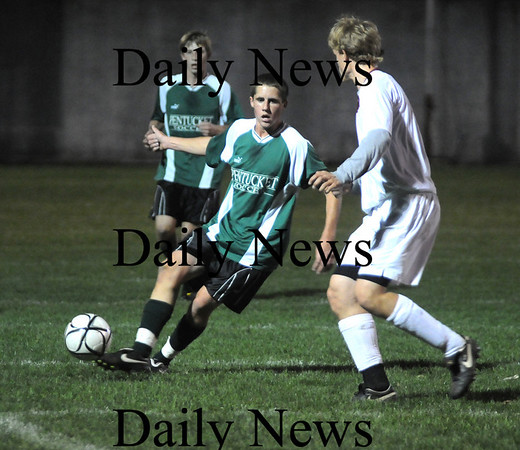 Newburyport: Newburyport 's Kyle Uhlig steps infront of Pentucket'sTylor Beaton in the 8th annual ALS Soccer Cup at War Memorial Stadium in Newburyport Thursday night. Jim Vaiknoras/Staff photo