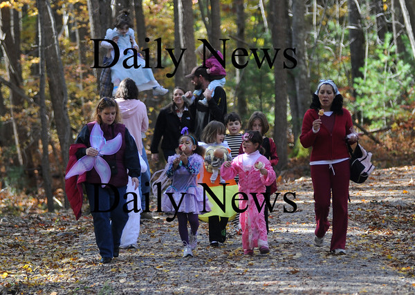 Salisbury: Kids and parents walk along the Salsibury Point Ghost Railtrail at the Fall Feastival and Halloween Hayride Sunday. Along with the hayride kids enjoyed pumpkin decorating, snacks and loads of ghoulish fun. The event was sponsered by the Salsibury Recreation Dept. Jim Vaiknoras/Staff photo