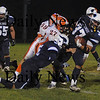 Byfield:  Triton's Brendan O'Neil fights for yardage against Ipswich at Triton Friday night. Jim Vaiknoras/Staff photo