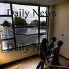Newburyport: Students at the Nock Middle School head past a window through which the new solar array can be seen. Jim Vaiknoras/Staff photo