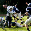 Lynnfield: Triton's Brendan O'Niel gains yardage against Lynnfield Saturday. Jim Vaiknoras/Staff photo