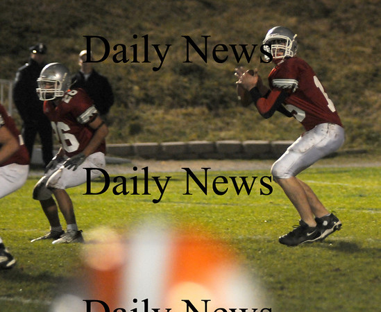 Amesbury: Amesbury quarterback Tyler Lay looks down field for a reciever during the Indian's home game Friday night against Ipswich. Jim Vaiknoras/Staff photo