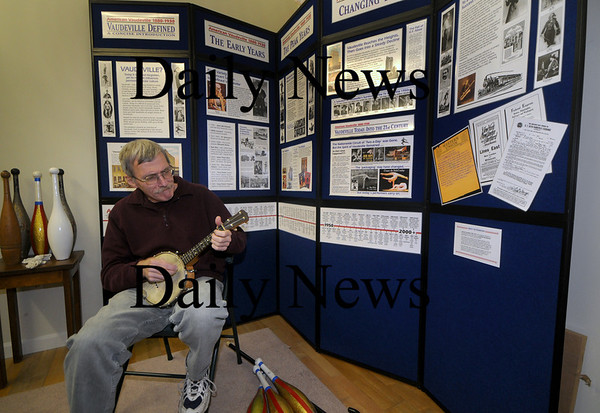 "Newburyport: Reg Bacon plays the banjo-ukulele in front of props and graphics for his show ""A Vaudeville Retrospective,"" which will be performed at Newburyport Public Library on Nov. 8.  Bacon is a juggler and musician who will re-create some of the old time vaudeville acts and give a history of the entertainment form. Jim Vaiknoras/Staff photoi"