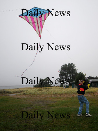 Salisbury: Bob Reichert of Lawrence flies his 16-foot bow kite (diamond-shaped) bicentennial kite in 1976 that was flown once at the reservation back then. He's recently gotten rejuvenated to fly again brought out that 16-foot bicentennial kite and flew it in Salisbury at the reservation Saturday. This isn't your modern-day kite made of nylon and steel rods, he says. His is made from sheet plastic and wood. He has been making kites for 30-plus years and flying these kites, some giant, in Salisbury and elsewhere. Jim Vaiknoras/Staff photo