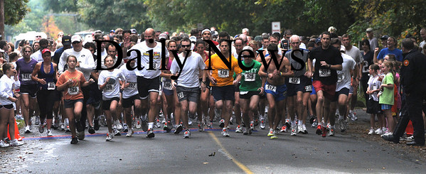West Newbury: Runners in the 20th annual Apple Harvest Race in West Newbury  make their way down Batchelor street Sunday morning. Jim Vaiknoras/Staff photo