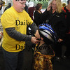 Amesbury:Spencer Butzen, 6, gets fitted for a new bike helmet by volunteer Steve Trenholm at the at Bike Safety Day Saturday at the Amesbury Healthcenter. Jim Vaiknoras/Staff photo