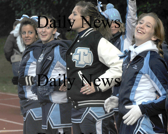 Lynnfield: The Triton cheerleaders wore gloves, hats and coats to stay warm during the Vikings game at Lynnfield Saturday/ Jim Vaiknoras/Staff photo