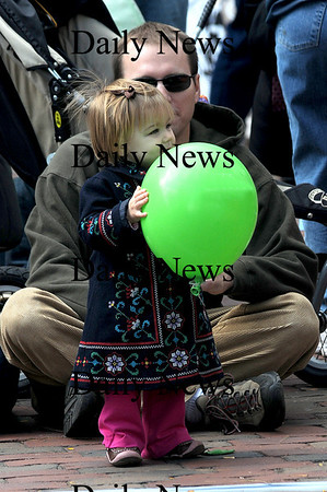 Newburyport: Georgia Howard, 15 months, enjoys the music and a balloon with her dad Robert at the annual Newburyport Harvest Festival Sunday in Market Square. Jim Vaiknoras/Staff photo