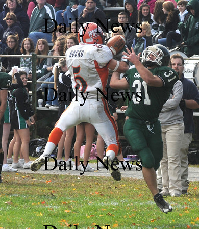 West Newbury: Ipswich's Nathaniel Bocko intercepts a pass intended for Pentucket's Austin Perreault during their game in West Newbury Saturday. Jim Vaiknoras/Staff photo