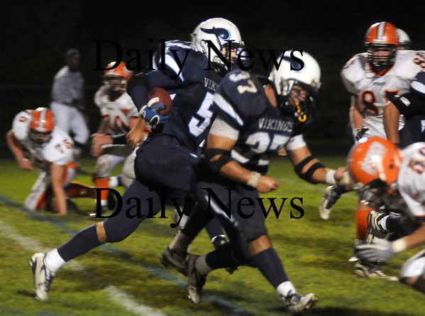 Byfield:  Triton's Derek Paquette runs for 6 point against Ipswich  at Triton Friday night. Jim Vaiknoras/Staff photo