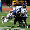 Lynnfield: Triton's Brendan O'Niel and Cody Miller  stop Lynnfield's Chris Grassi at Lynnfield Saturday. Jim Vaiknoras/Staff photo