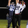 Byfield: Triton's Mike Foley  pull down a pass over a Witman-Hanson defender Friday night at Triton. Jim Vaiknoras/Staff photo