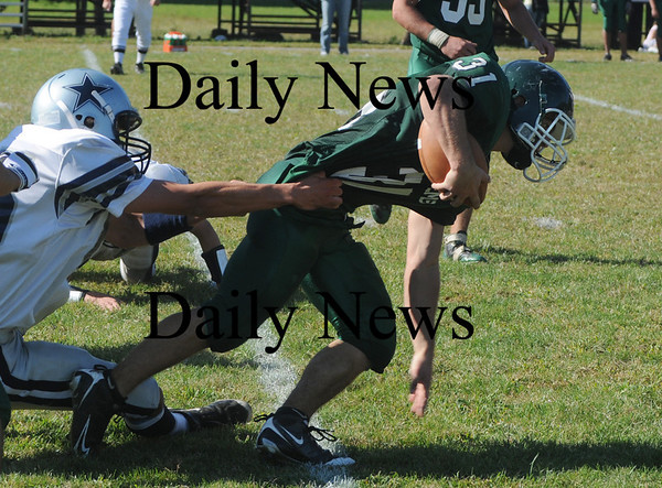 West Newbury: Pentucket's Austin Perreault is brought down returning a punt against Hamilton-Wenham Saturday . Jim Vaiknoras/Staff photo